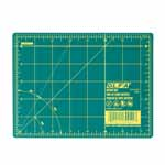 "Whether you're new to crafting or a pro, you'll appreciate this OLFA® rotary mat. It not only protects your cutting surfaces, it protects the edges of rotary blades. The mat's grid lines are designed for easy measuring and accurate cutting of straight lines and precise angles. Good For: protecting cutting surfaces and extending the life of your rotary blades. 1.5mm thick. Double-sided mat is solid green on one side for general crafting and has yellow grid lines on other side for detailed cutting. Self-healing finish reseals surface cuts, providing a continually smooth surface for all cutting projects. Store flat and out of direct sunlight. For use only with rotary blades and blades; fixed-blade knives blade may damage mat. Mat: 6 1/2"" x 9"" (17 x 23 cm). Grid: 6"" x 8"" (15 x 20 cm)"