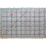 "Convenient size for home, travel or taking to classes. Self healing cutting mat side is marked in imperial measurements with 30, 45 and 60 degree angles. Ironing Board side is ideal for pressing, sewing, quilting and crafting projects. Mat: 12"" x 17 1/2"" (31 x 45 cm). Grid: 11"" x 17"" (28 x 43 cm)"