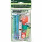 Assorted knitting accessories including point protectors, stitch markers, needle gauge, and row counter within a reusable plastic pouch. Clover #3003