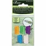 5 pieces. Non slip holder winds around knitting needles. Clover #3123